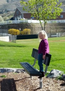 Posing at the park - sometimes she loves to be a girly girl.