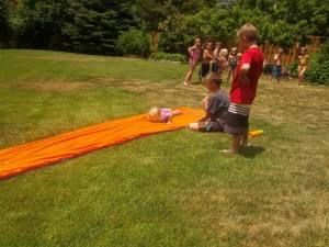 Rose learning to slip n slide at the Grandparents house