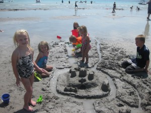 Cali and cousins and their sand castle