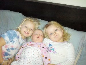 these girls love their sister and love the camera