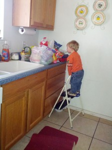 Helping Himself - Raymond figured out where the junk food stash was at Grandma's house!!