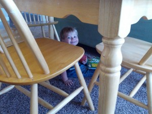 A little Chill time under the table with his Mickey Mouse book :)