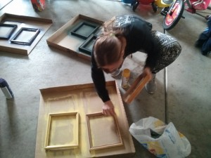 Tracie painting some frames for me!