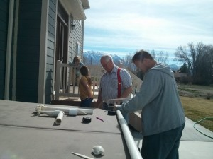 Dad and Ryan working on my hot tub!