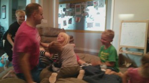 the kids love wrestling with dad