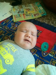 sad baby on his awesome new blanket from Lan!