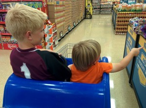 my 10 year old and 3 year old in the grocery cart... he doesn't realize how big he is :)